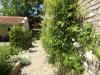 Tuinrenovatie van een ruime patiotuin bij een monumentaal pand in Dirksland op Goeree Overflakkee.